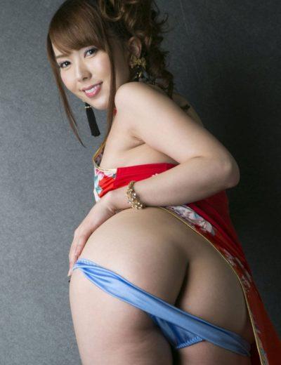 A Korean masseuse showing her half naked bum