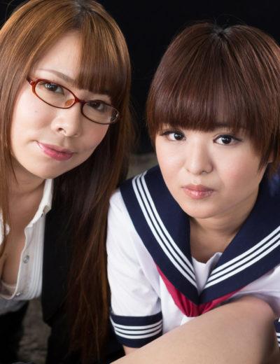 Two Asian girls offering a 4 hands massage