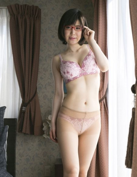 A gorgeous Asian masseuse stood up in her underwear wearing glasses